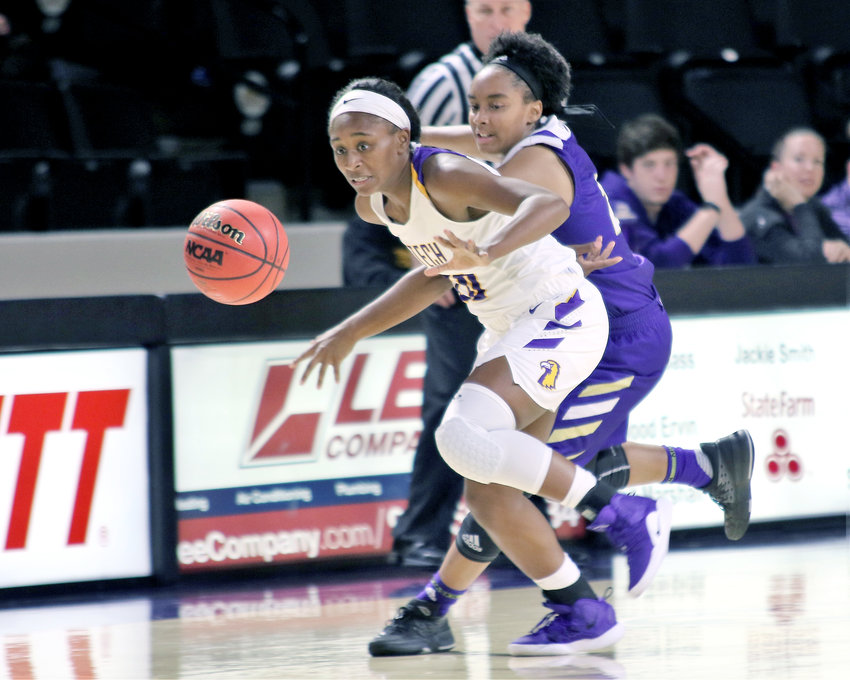 Tennessee Tech's Kesha Brady, front, fights for a loose ball during a game earlier this season. The Golden Eagles hope their season is not over yet.