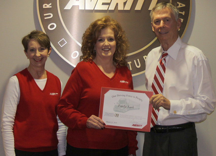 Denise York, center, is presented her 30-year service award by Averitt customer information leader Sandy Fleming, left, and Averitt chairman and chief executive officer Gary Sasser, right.