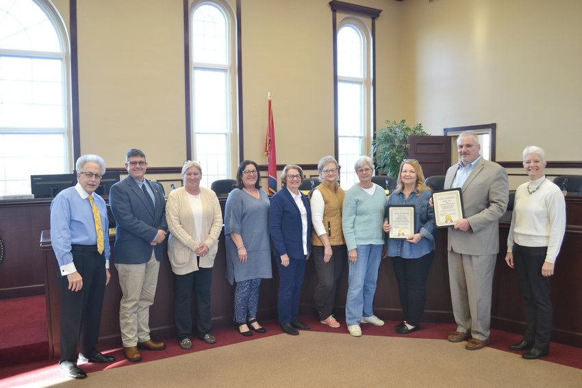 The people responsible for maintaining the Imagination Library, which provides free books to children, are given special recognition from the county commission. From left, County Clerk Wayne Nabors; commissioners Jimmy Neal, Kim Bradford and Cathy Reel; Diane Duncan, Teri Anderson, Joanne White and Barbara Wilhite with Imagination Library; Chuck Sparks with the CRMC Foundation; and commissioner Cindy Adams.