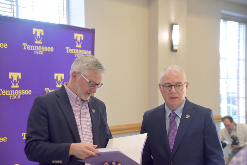 Tennessee Tech President Phil Oldham, left, and Lee Wray, chief of staff, preparing to announce Tech's new grand challenge, Rural Reimagined.