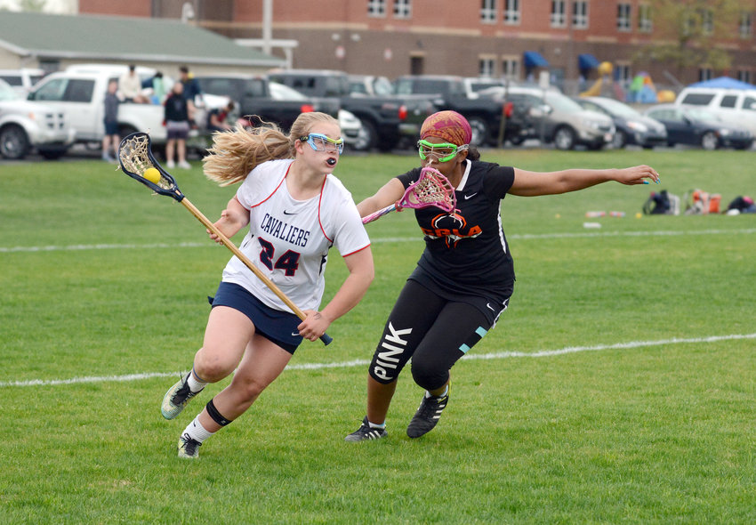 Cookeville's Emma Bailey, left, cuts to the goal during the Lady Cavs' 13-2 win over CGLA Friday at CHS.