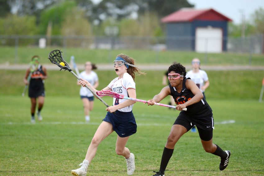 Cookeville's Ella Chaphe, left, retains possession during the Lady Cavs' 13-2 win over CGLA Friday at CHS.
