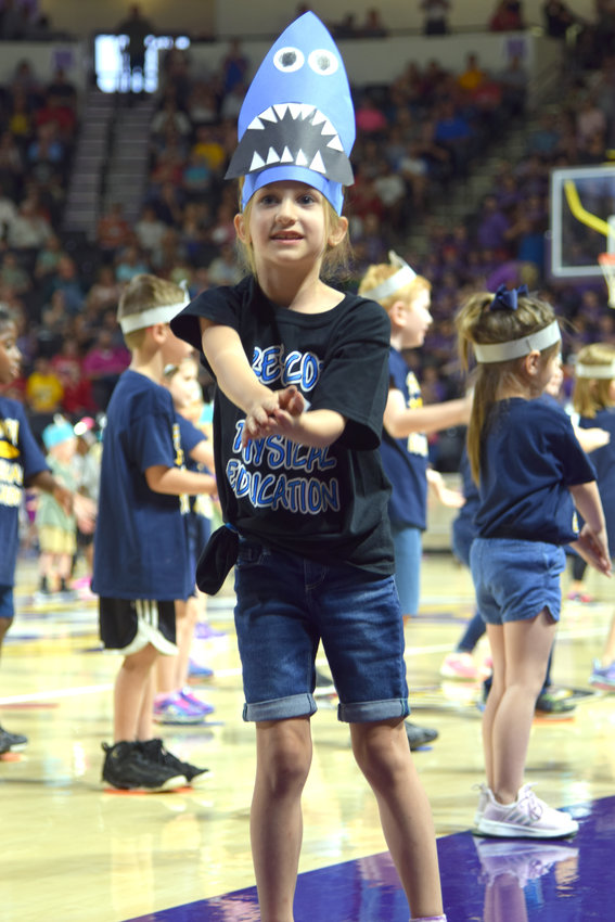 Prescott South Elementary School kindergarten student Taylyn Beaty performs a dance with kindergarten students from across the Putnam County School System at Thursday night's annual Festival of Movement at Tennessee Tech's Hooper Eblen Center.
