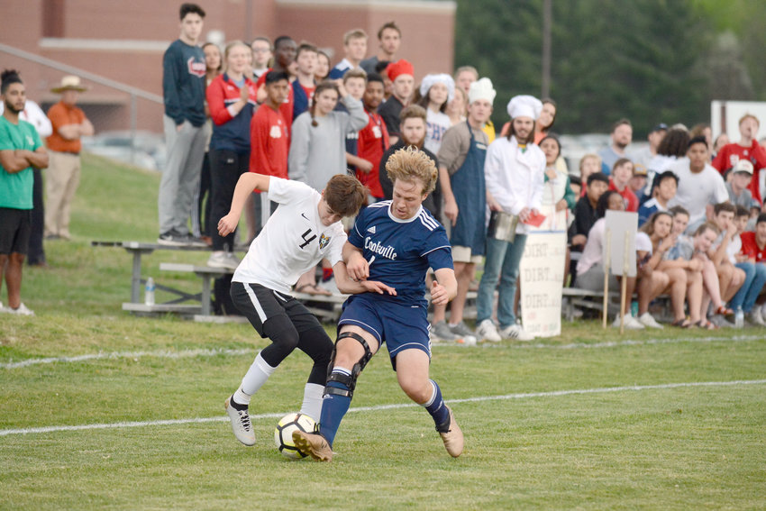 Cookeville's Jackson Bilbrey, right, steals the ball during the Cavs' 2-1 loss to Rhea County Thursday night at CHS.
