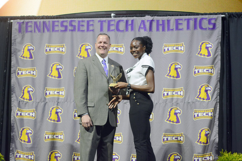 Tennessee Tech's Khemani Roberts, right, receives an award at Tech's annual Golden Wings Awards earlier in April at TTU.