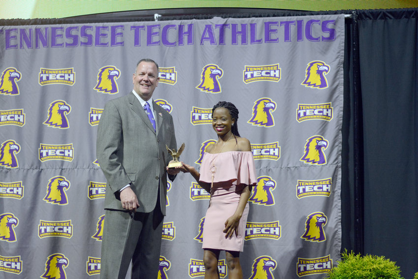 Tennessee Tech's Purity Sanga, right, receives an award at Tech's annual Golden Wings Awards earlier in April at TTU.