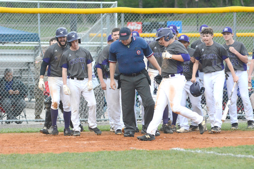 Monterey's Parker Stout, front, is greeted at home by his teammates after hitting a home run earlier this year against Trousdale County. Stout and the Wildcats will open the region tournament Monday at South Pittsburg.