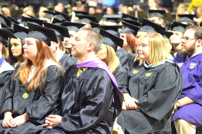 Upperman High School teachers and graduates listen to speakers during Friday night's graduation ceremony at Tennessee Tech.