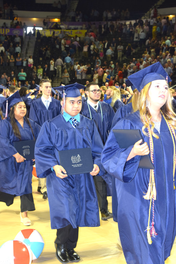 Cookeville High School graduates carry their new diplomas out of Saturday morning's ceremony at Tennessee Tech.
