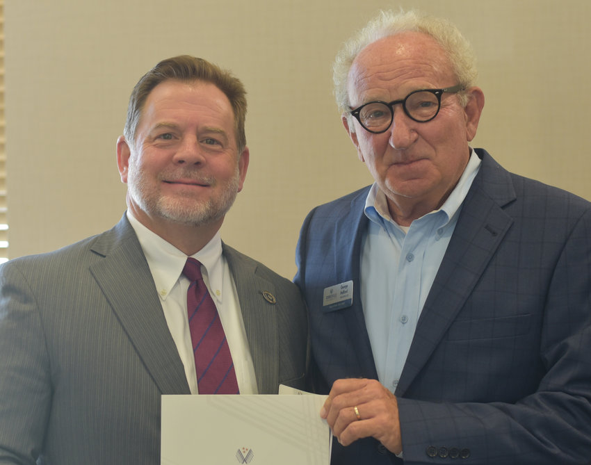 David Hill of Tennessee Bible College was honored at the Leslie Town Centre for the anniversary of joining the Cookeville Chamber.
