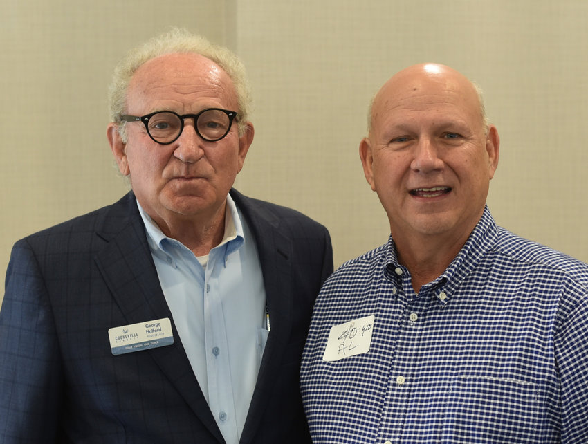 First Realty Company's Al Enochs, right, was honored for 40 years of being a member of the Cookeville Chamber by Chamber CEO George Halford.