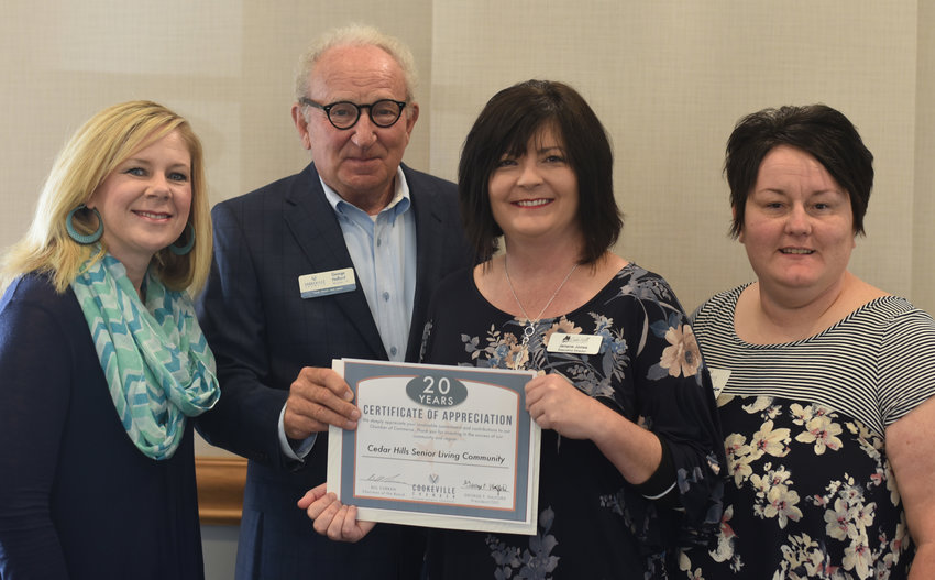 Cedar Hills Living Community was honored for 20 years of membership with the Cookeville Chamber. Chamber CEO George Halford presented the award to Cindy Lafever, left, Jenene Jones and Rebekah Randolph, right.