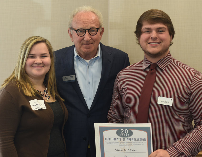Country Inn & Suites' Mackenzey Brock, left, and Brandon Darnell were honored for their business's 20 year anniversary of joining the Cookeville Chamber.