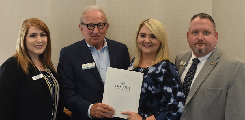 First Volunteer Insurance was honored for their anniversary of joining the Cookeville Chamber. Chamber CEO George Halford presented the award to Thea Wyatt, left, Kelly Sullivan and Kevin Presley.