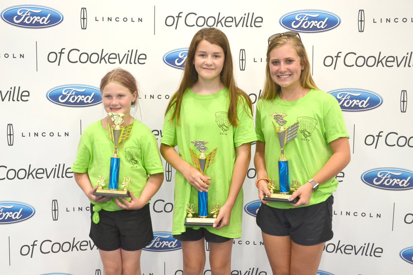 The winners of the 17th Cookeville Soap Box Derby show off their trophies, from left, Haylee Furton, Maizy Jolley and Molly Allison. The three will compete in the International All-American Soapbox Derby July 20 in Akron, Ohio.
