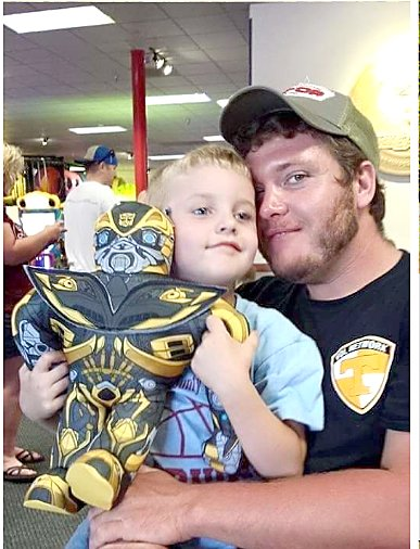 Spencer Utility Department employee Mickey Fisher, right, and his son Layton, left. Fisher died in an accident while at work, which led to Tennessee Occupational Safety and Health Administration (TOSHA) issuing six violations to the city.