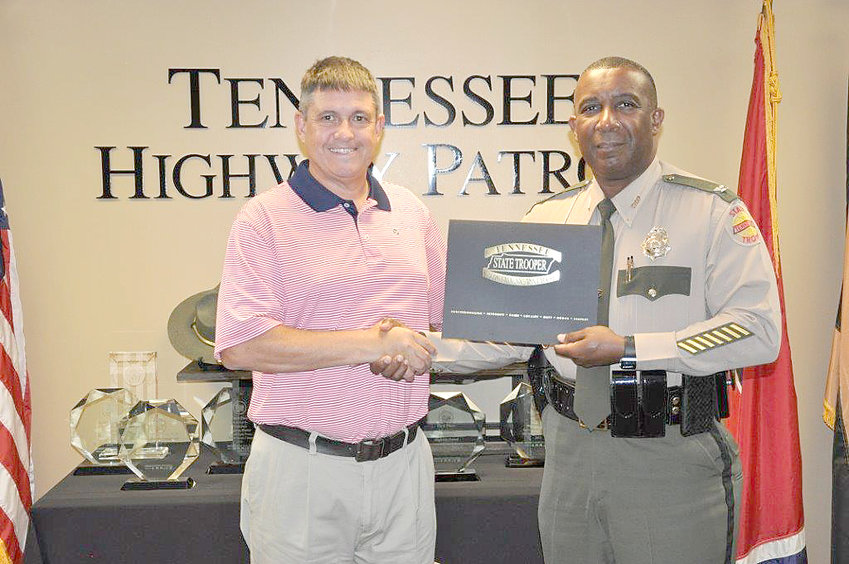 Jimmy Neal, left, is retiring from the Tennessee Highway Patrol after more than 25 years of service. Colonel Derek Stewart, right, congratulates him on his retirement.