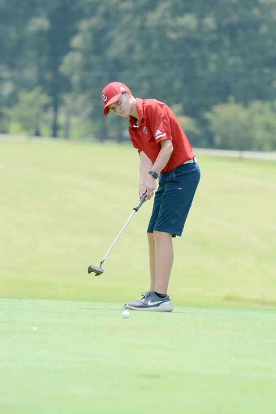 Cookeville's Seth Clayton putts during a match against Warren County and White County Monday at the Golden Eagle Golf Club.