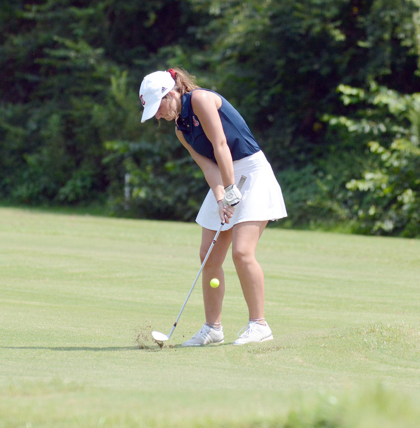 Cookeville's Savannah Pearson chips to the green during a match against Warren County and White County Monday at the Golden Eagle Golf Club.