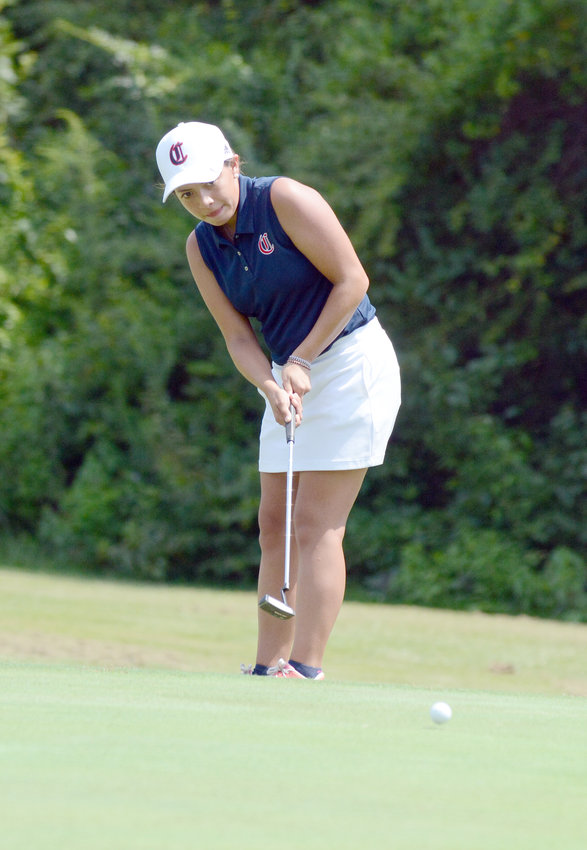 Cookeville's Hope Homar putts during a match against Warren County and White County Monday at the Golden Eagle Golf Club.