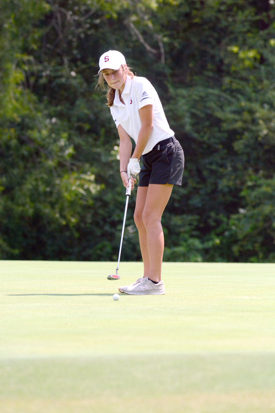 White County's Morgan Quick putts during a match against Warren County and White County Monday at the Golden Eagle Golf Club.