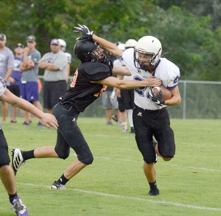 Monterey's Chandler Bowden, right, stiff-arms a Coalfield defender during a scrimmage at MHS on Friday.