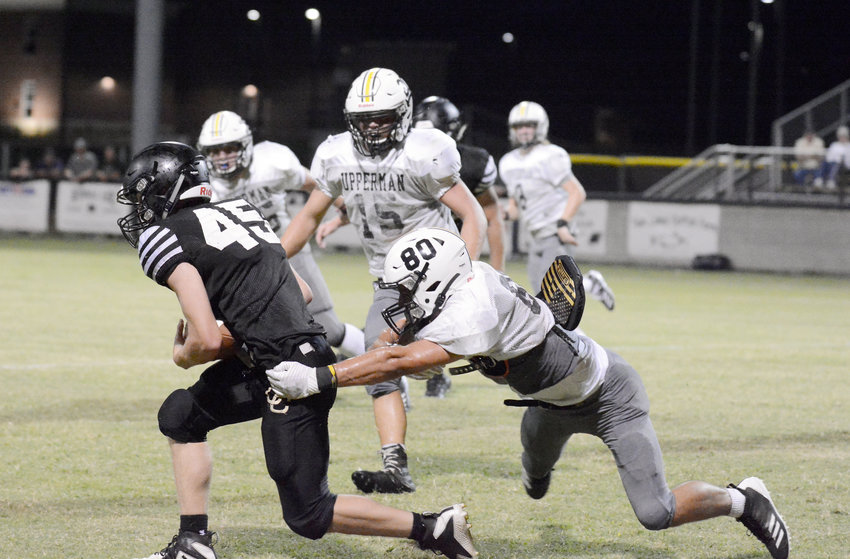 Upperman's Jake Dutchess, right, wraps up a Clay County defender during a scrimmage at UHS on Friday.