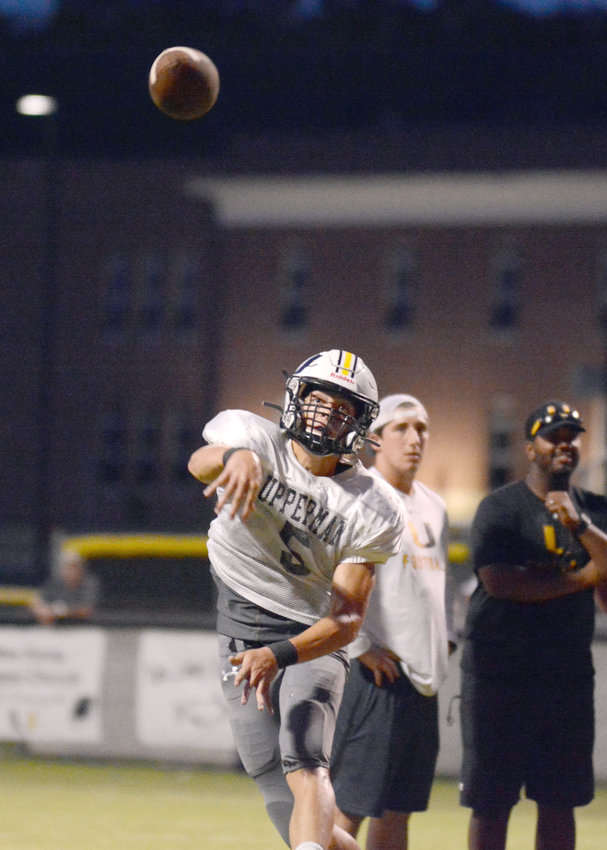 Upperman's Donoven McCallister passes during a scrimmage at UHS on Friday.