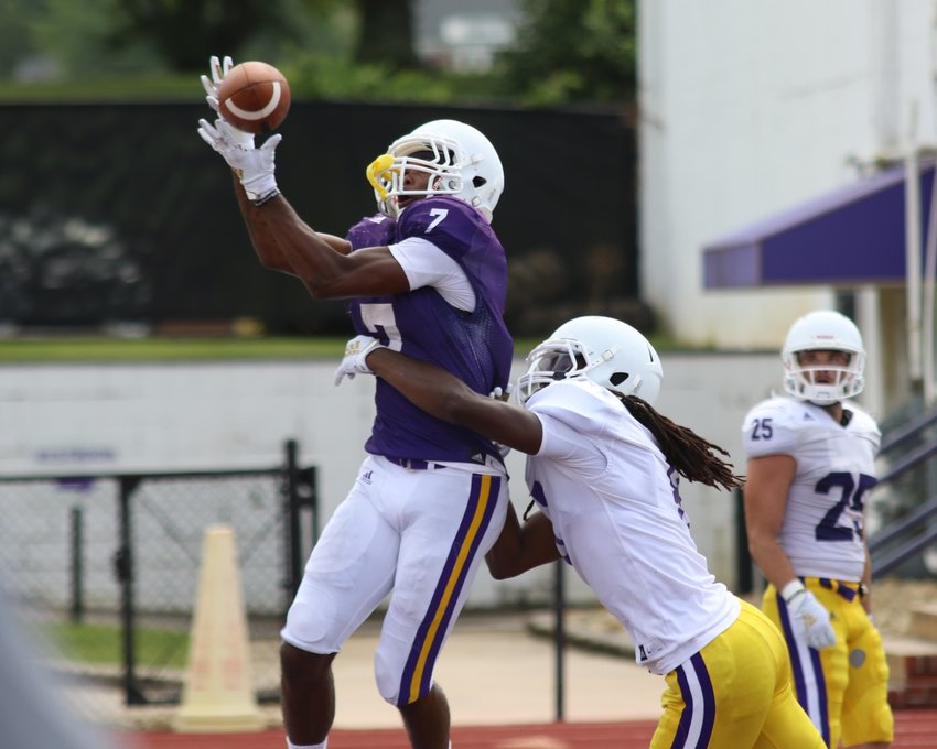 Tennessee Tech freshman wide receiver Metrius Fleming, left, goes high for a pass during practice Wednesday afternoon at Tucker Stadium. The Golden Eagles are in the middle of fall camp in preparation for their season opener with Samford Aug. 31 at home. Kickoff is set for 6 p.m.