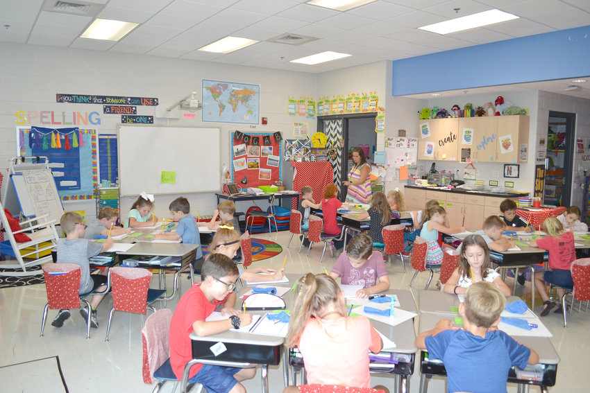 Students work on assignments Thursday in Lindsay Null's classroom at Algood Elementary School. The school is operating at 97.8 percent of its maximum capacity.