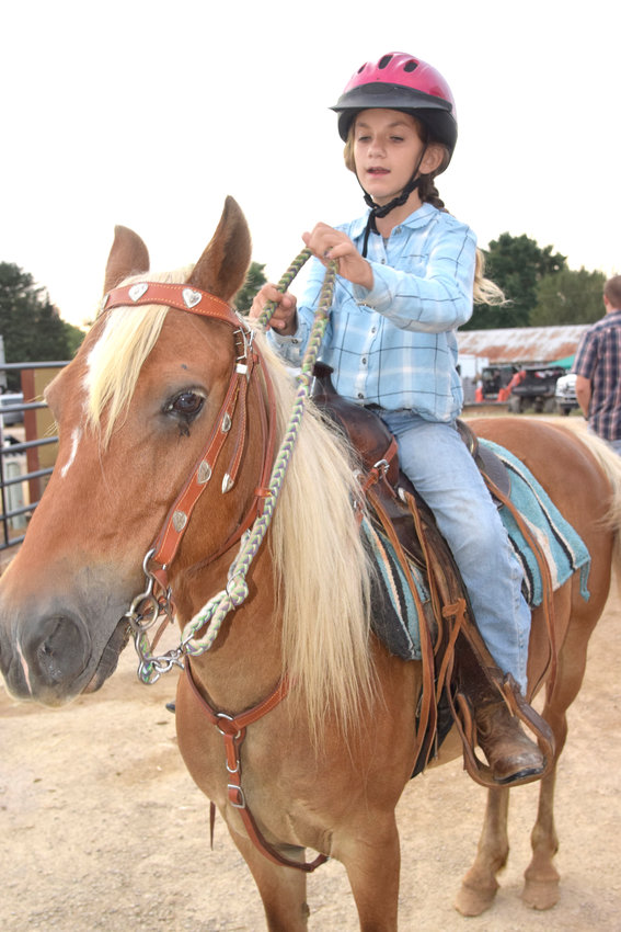 Nine-year-old Lilly Howell rides the rescue pony Cinnamon Thursday night in the pony pleasure competition at the Putnam County Fair. Cinnamon was rescued by Nicole Belknap, who gave the pony to Howell.