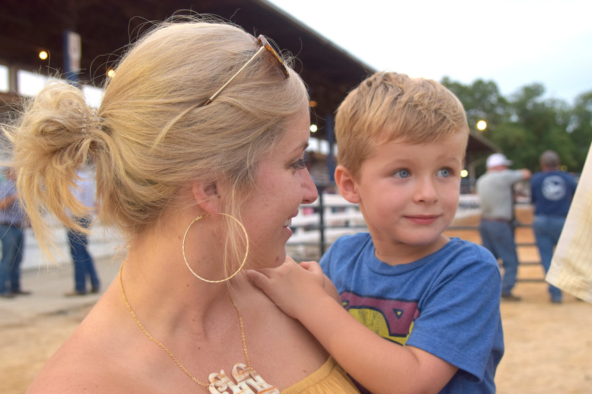 Erin Hawkins and her 4-year-old son, Hollace, at the Putnam County Fair Thursday night just before the herding dogs demonstration.