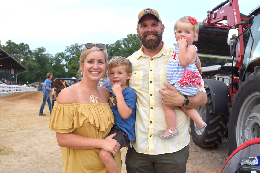 The Hawkins family enjoyed the horse show and the herding dogs demonstration at the Putnam County Fair Thursday night. From left are Erin, Nayvie May, Daniel and Hollace.