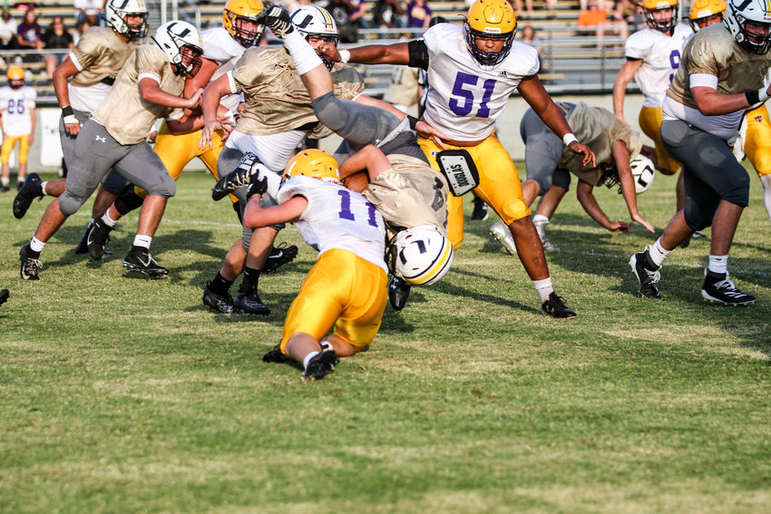 Upperman High School's Dalton Barney goes up and over a Trousdale County tackler during a scrimmage Friday night in Baxter. Stewart and the Bees will open the regular season with Cookeville on Aug. 22.