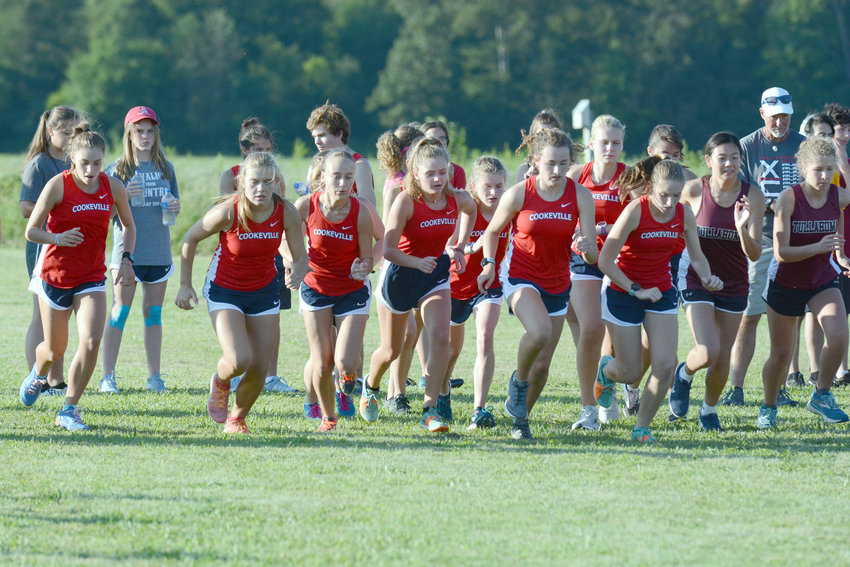 The Cookeville High School girls' cross country team jumps off the starting line during its annual MSCCA Jamboree Thursday at CHS.