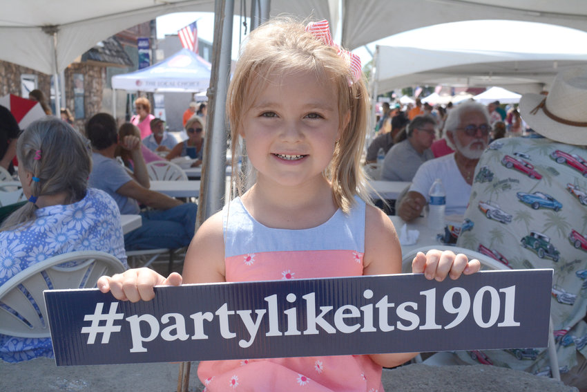 Temperance Sparks, 5, enjoys the Bank of Putnam County celebration and ribbon cutting Saturday.