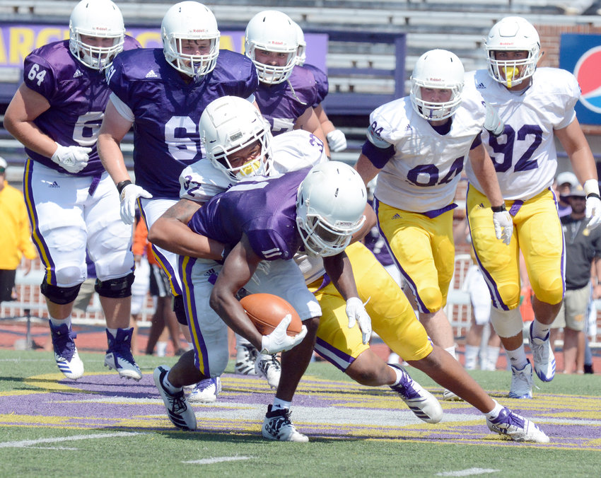 Freshman Miles Younger (32) tries to bring down freshman tailback Quinton Cross during Tennessee Tech's final scrimmage of the preseason Saturday. The Golden Eagles will now begin their countdown to their season opener Aug. 31 against Samford.