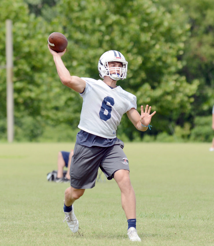Cookeville's Stockton Owen passes during a 7-on-7 training camp at CHS in July.