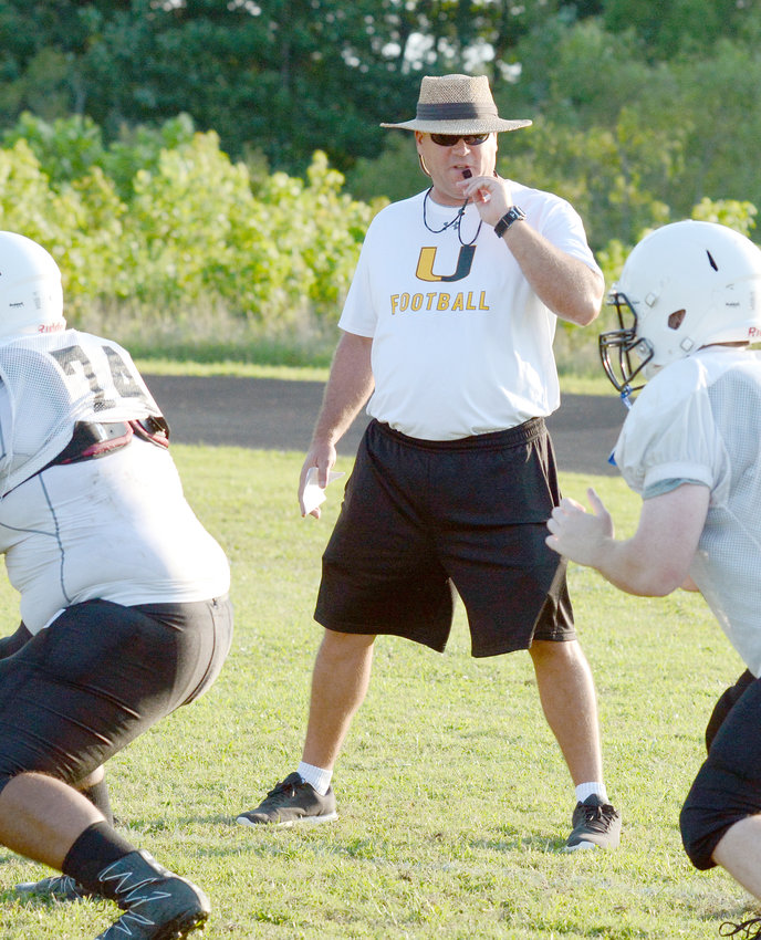 Upperman High School Football Coach Adam Caine watches practice as his team prepares tonight's battle with Cookeville.
