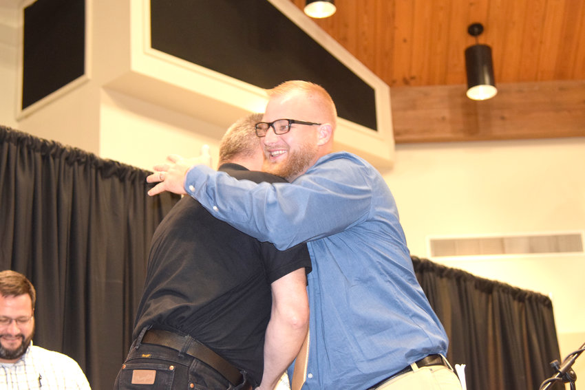 Life Transformation graduate Glenn Honeycutt hugs Cookeville Rescue Mission Executive Director Bruce Bailey after receiving a Bible and certificate Friday night for being one of the first six to complete the new program at the rescue mission.