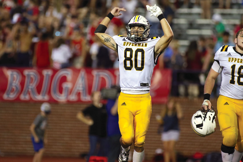 Upperman's Jake Dutchess celebrates Saturday night after the Bees beat Cookeville 21-20.