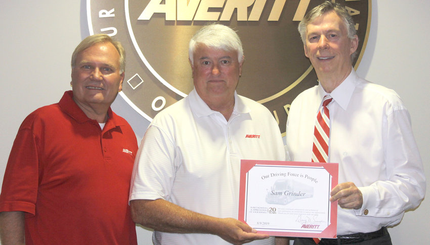 Sam Grinder, center, is welcomed to the Averitt Over 20 Team by director of purchasing Randy Dunn, left, and Averitt chairman and chief executive officer Gary Sasser, right.