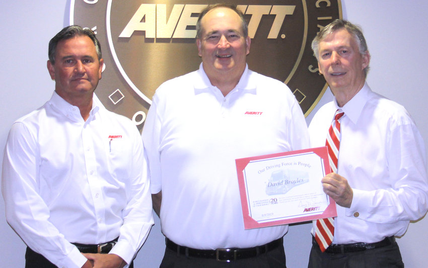 Director of driver services David Broyles, center, is welcomed to the Averitt Over 20 Team by vice president of corporate transportation Danny Crooks, left, and Averitt chairman and chief executive officer Gary Sasser, right.