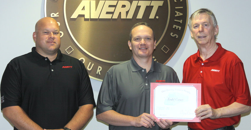 Todd Casey, center, is welcomed to the Averitt Over 20 Team by fleet region manager Dewayne Tinch, left, and Averitt chairman and chief executive officer Gary Sasser, right.