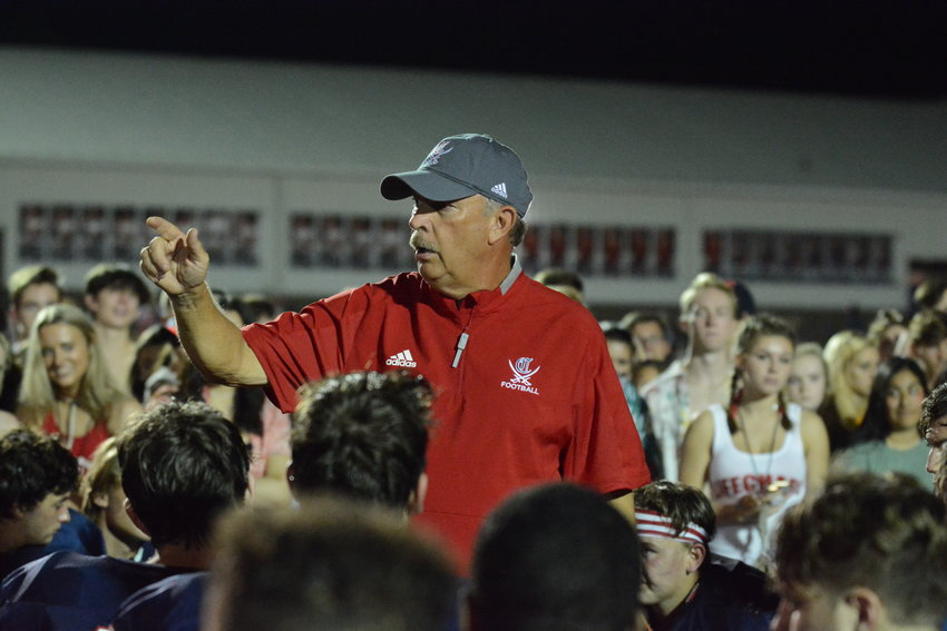 Cookeville head football coach Jimmy Maynord talks to his team after the Cavs' 35-17 loss to Riverdale Friday at CHS.