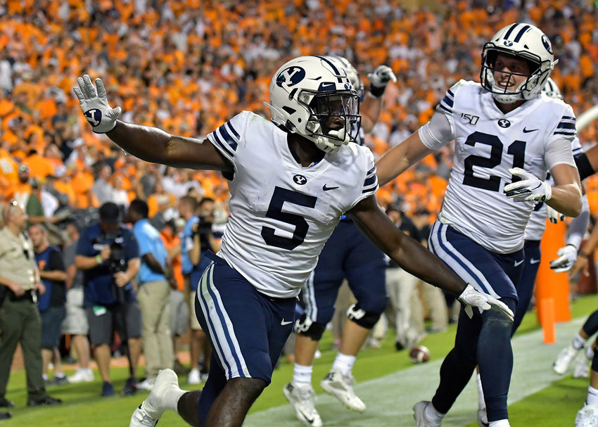 Brigham Young Cougars running back Ty'Son Williams (5) celebrates his game-winning touchdown in the second overtime of an NCAA football game against the Tennessee Volunteers Saturday, Sept. 7, 2019, at Neyland Stadium in Knoxville, Tenn. BYU defeats UT 29-26 in double overtime.