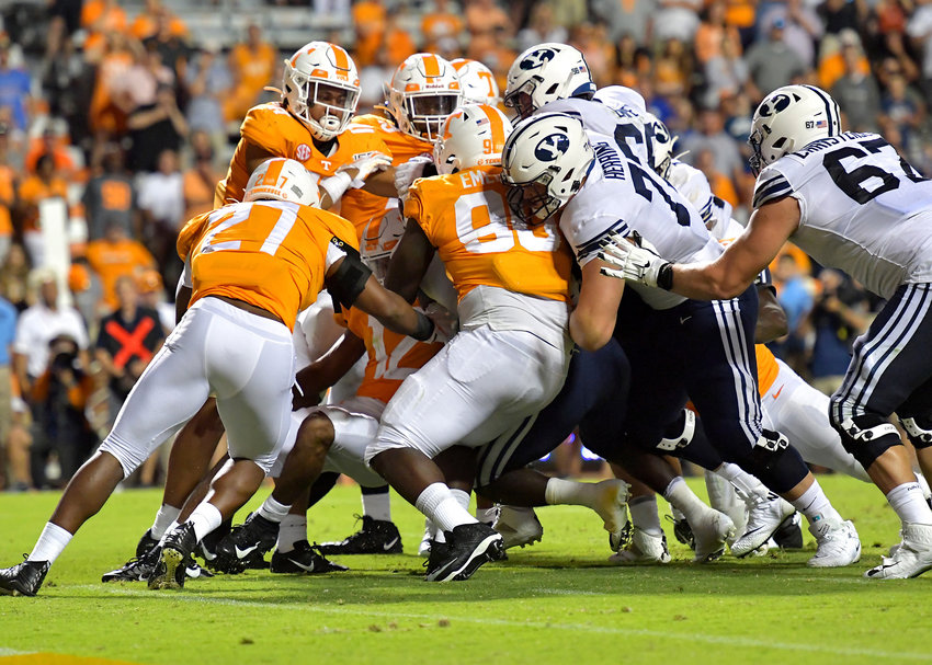 A pack of Brigham Young Cougars successfully move Cougars running back Ty'Son Williams (5) across the goal line for the game-winning touchdown in the second overtime of an NCAA football game Saturday, Sept. 7, 2019, at Neyland Stadium in Knoxville, Tenn. BYU defeats UT 29-26 in double overtime.