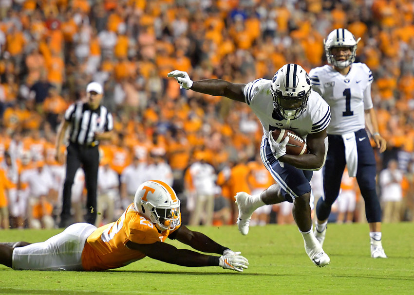 Tennessee Volunteers linebacker Will Ignont (23) misses the tackle of Brigham Young Cougars running back Ty'Son Williams (5) during the second overtime of the NCAA football game Saturday, Sept. 7, 2019, at Neyland Stadium in Knoxville, Tenn. BYU defeats UT 29-26 in double overtime.