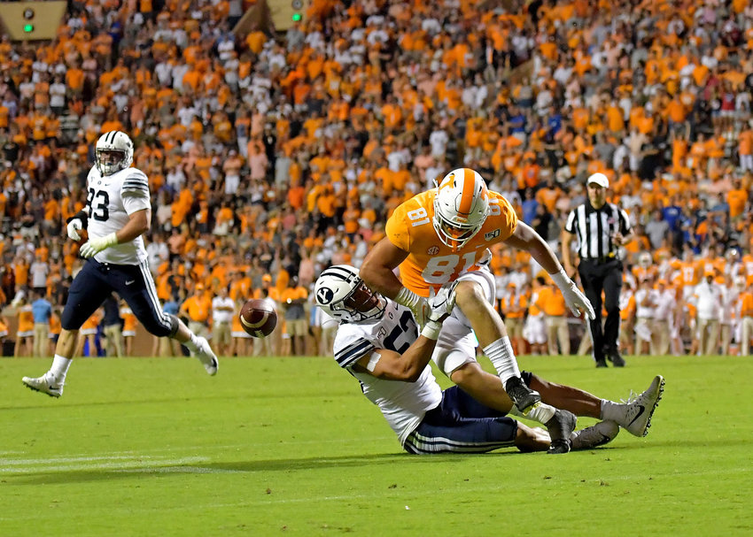 Tennessee Volunteers tight end Austin Pope (81) can't hold onto a pass under pressure from Brigham Young Cougars defensive lineman Trajan Pili (52) in the first overtime of an NCAA football game Saturday, Sept. 7, 2019, at Neyland Stadium in Knoxville, Tenn. BYU defeats UT 29-26 in double overtime.
