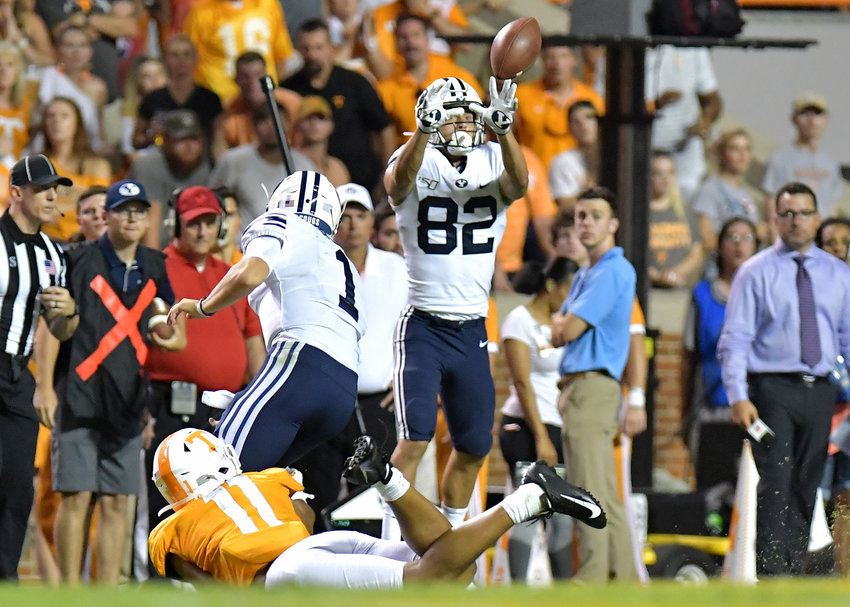 Brigham Young Cougars quarterback Zach Wilson (1) gets off a pass to wide receiver Talmage Gunther (82) just before being tackled by Tennessee Volunteers linebacker Henry To'o To'o (11) in the second half of an NCAA football game Saturday, Sept. 7, 2019, at Neyland Stadium in Knoxville, Tenn. BYU defeats UT 29-26 in double overtime.